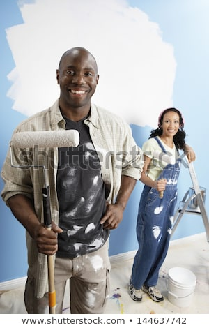 Painter standing on a stepladder Stock photo © stryjek