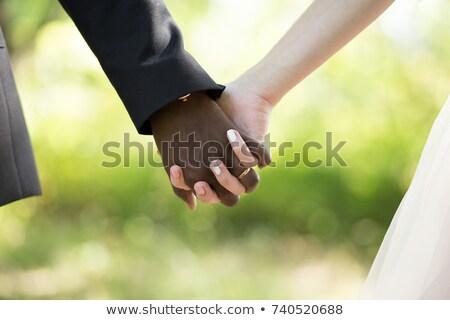 De mãos dadas recém-casados casamento menina amor Foto stock © m_pavlov