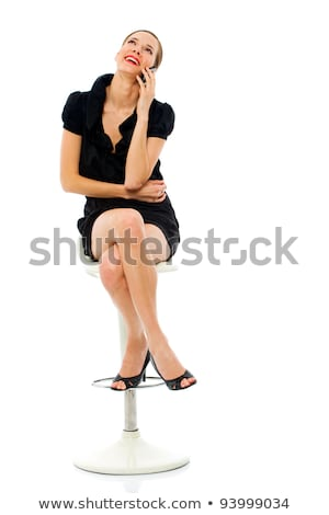 smart woman sitting on a stool holding a cellphone on white background stock photo © ambro