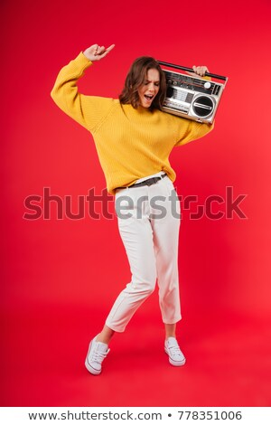 fun loving woman listening to music stock photo © konradbak