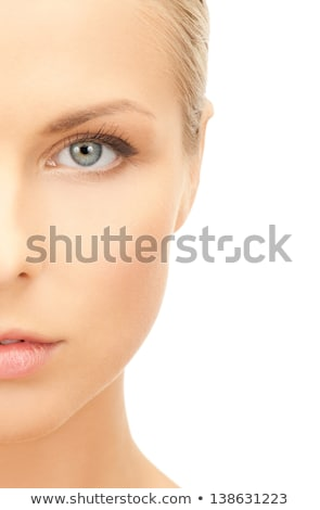 Half face close-up portrait of young woman Stock photo © zastavkin