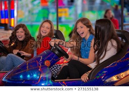 group of girls at carnival fair. Stock photo © godfer