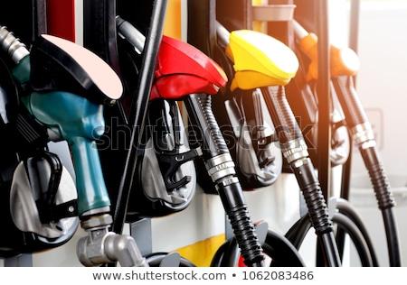 Benzinpumpa benzin dízel függőleges kép kéz Stock fotó © Koufax73