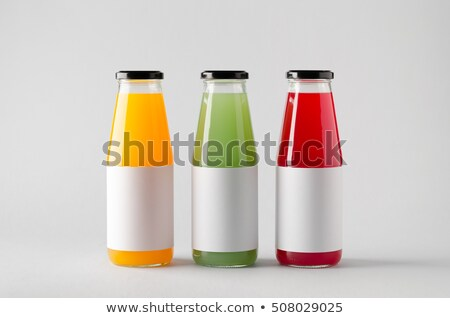 Orange and strawberry juices in glass bottles Stock photo © ozaiachin