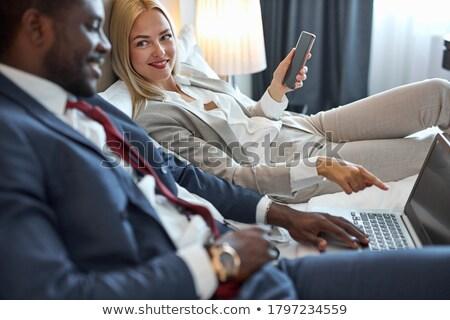 çekici · sarışın · kadın · poz · yatak · şehvetli · bakıyor - stok fotoğraf © neonshot