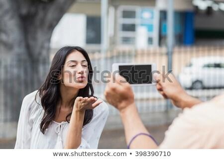 fond woman sending kisses by phone Stock photo © Giulio_Fornasar