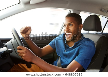 Portrait Of Young Male Driver Looking Out Of Car Window Stock photo © HighwayStarz
