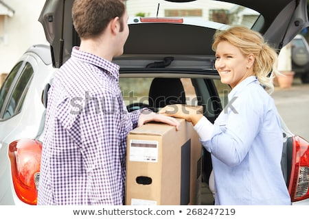 Couple Unloading New Television From Car Trunk Stock photo © HighwayStarz