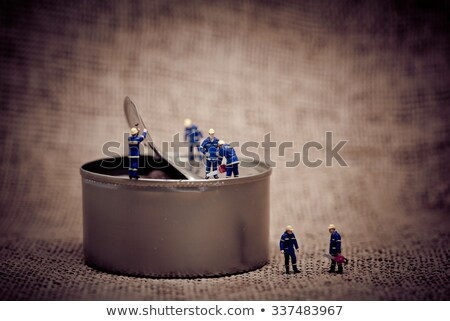 Miniature workers opening a can. Color tone tuned photo. Stock photo © Kirill_M