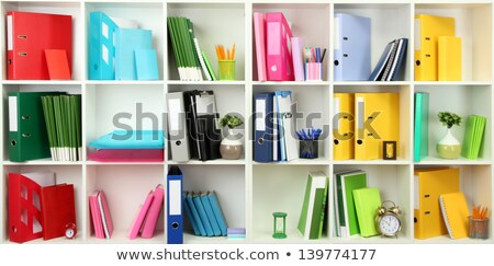 White office shelves with different stationery, close up Stock photo © tetkoren