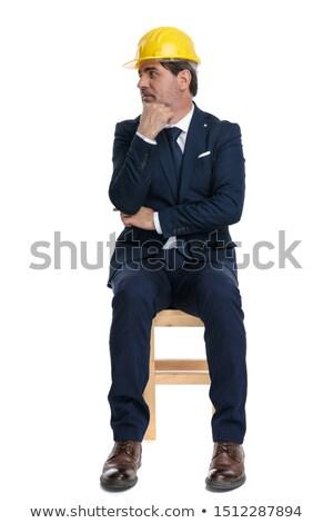 Hombre traje sesión estudio tocar barbilla Foto stock © feedough