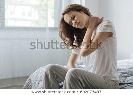 mujer · sufrimiento · dolor · de · cuello · cara · masaje · atrás - foto stock © dolgachov