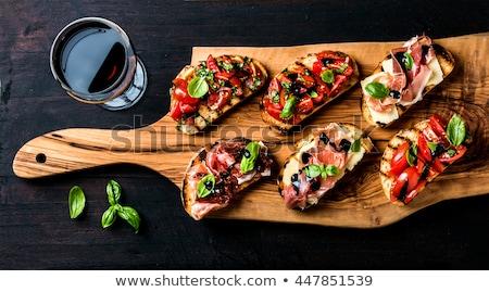 voedsel · tomaat · snack · voorgerechten · basilicum · mozzarella - stockfoto © badmanproduction