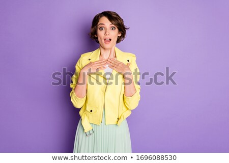 Smiling woman pointing finger at herself Stock photo © deandrobot