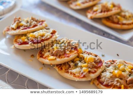 Servido mini pizza caseiro ovo frito cebolas Foto stock © badmanproduction