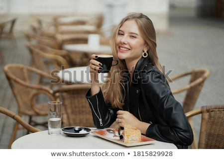 Breakfast with a beautiful young blond. Stock photo © lithian