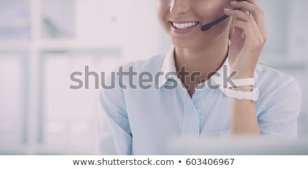 Beautiful customer service operator woman with headset Stock photo © Nobilior