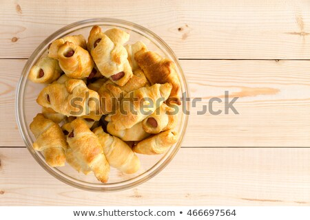 Glass plate heaped with fresh hot dog croissants Stock photo © ozgur