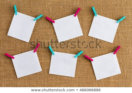 Six misaligned blank white notepads on hessian Stock photo © ozgur