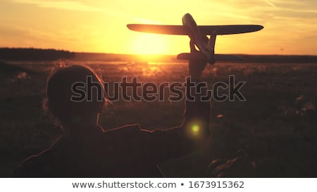 child with airplane at sunset Stock photo © adrenalina