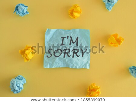 Stock photo: Sorry text on notepad