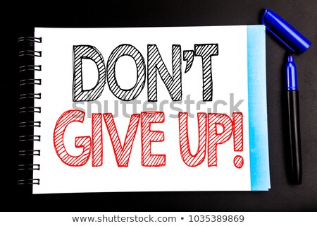 Never give up text on notepad and pencil Stock photo © fuzzbones0