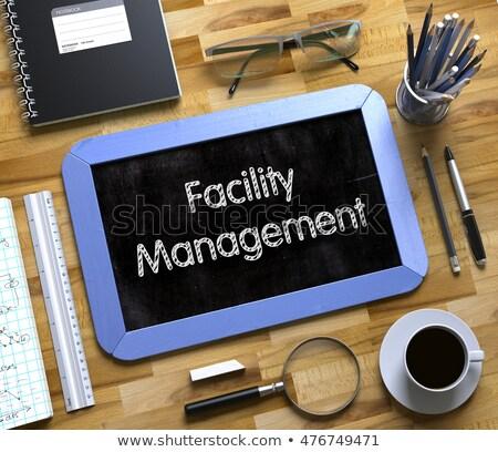 facility management concept on small chalkboard 3d illustration stock photo © tashatuvango