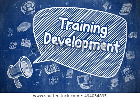 Training Courses - Cartoon Illustration on Blue Chalkboard. Stock photo © tashatuvango