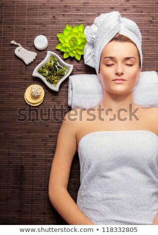 Bela mulher mentiras sauna estância termal relaxar massagem Foto stock © dmitriisimakov