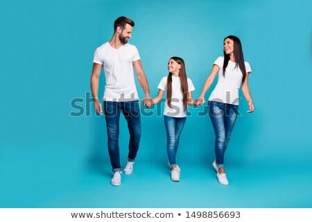 couple walking on the street holding hands stock photo © tekso