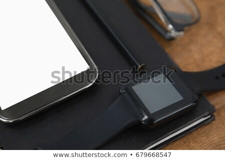 diary, smart watch, pencil, smartphone and spectacles on wooden background Stock photo © wavebreak_media