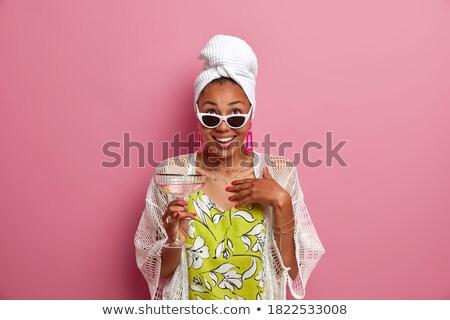 Koncentrált fiatal hölgy visel napszemüveg kép Stock fotó © deandrobot