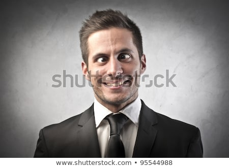 young business man making a stupid face  Stock photo © feedough