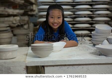 portrait of happy girl sitting at worktop stock photo © wavebreak_media