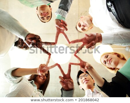 group of international people showing peace sign Stock photo © dolgachov