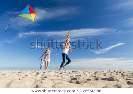 Stock photo: People on beach with kite