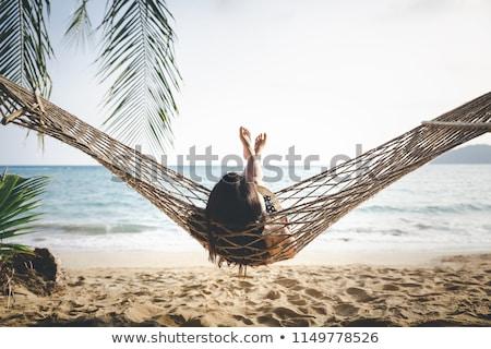 женщины расслабляющая гамак женщину портрет улыбаясь Сток-фото © IS2