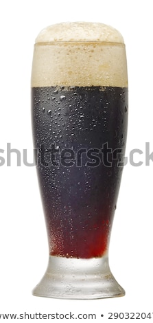 Cold glass of dark beer with foam and dew Stock photo © DenisMArt