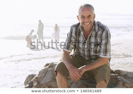 Középkorú férfi kövek portré kő mosolyog boldogság Stock fotó © IS2