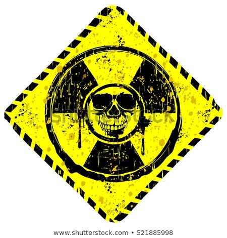 abstract grunge background with the emblem of radiation stock photo © olgayakovenko