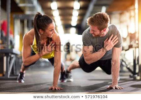 çift · spor · salonu · egzersiz · uygunluk · kız - stok fotoğraf © dash