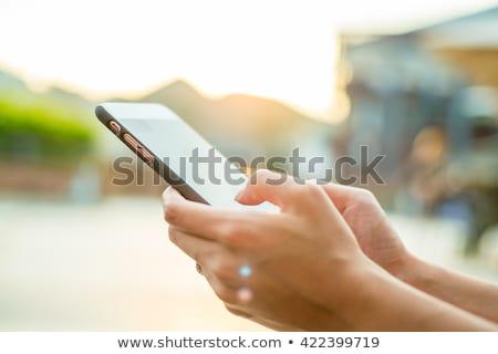 Woman holding ringing mobile phone. Stock photo © RAStudio