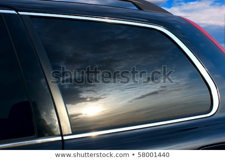 Sunlight reflecting on car window Stock photo © IS2