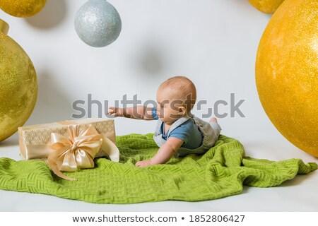 Baby crawling towards gift box Stock photo © IS2