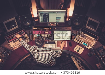 hands on mixing console at sound recording studio stock photo © dolgachov