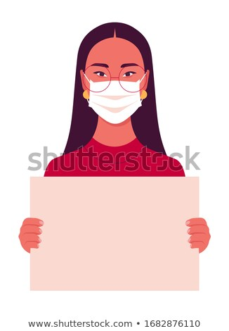 woman in medical mask protests with a poster Stock photo © studiostoks