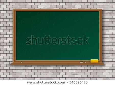 Green Blackboard with Chalk and Sponge Stock photo © Voysla