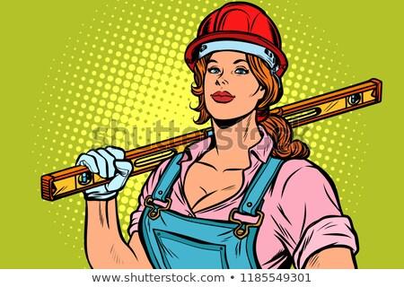 Pop art woman Builder with level Stock photo © studiostoks