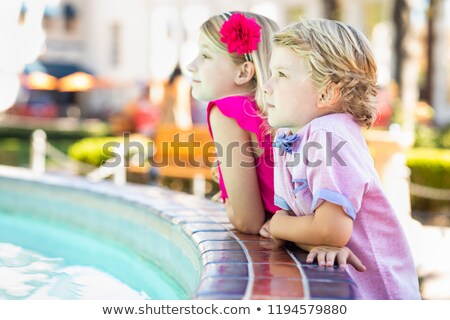 Cute Young Caucasian Brother and Sister Enjoying The Fountain At Stock photo © feverpitch
