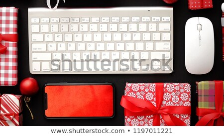 Computer keyboard, modern smartphone, mouse and christmas boxed gifts Stock photo © dash